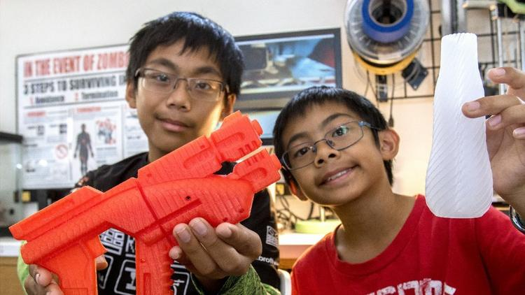 Escondido students Calexis and Calramon Mabalot opened a business making products through 3D printing including a robotic prosthetic hand. They show a pl - BROTHERS BUILD CUTTING-EDGE 3D PROSTHETIC HANDS