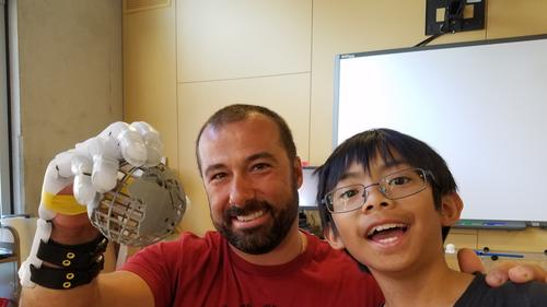 nick-sissakis-shows-the-prosthetic-hand-that-escondido-student-calramon-mabalot-and-his-brother-calexis-built-for-him-with-their-3d-printer-photo-courte