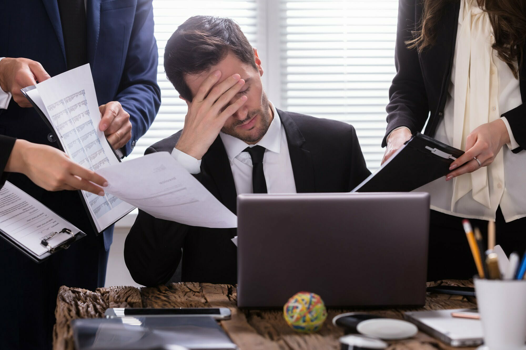 Stressed Businessman Sitting In Office