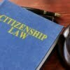 Book with title Citizenship Law and gavel.
