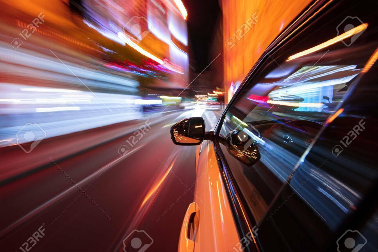 Speeding car driving in a night city.