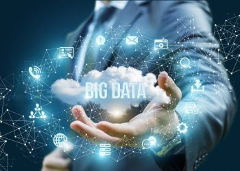 Businessman showing a cloud with the words big data .