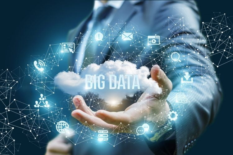 Businessman showing a cloud with the words big data on blue background.