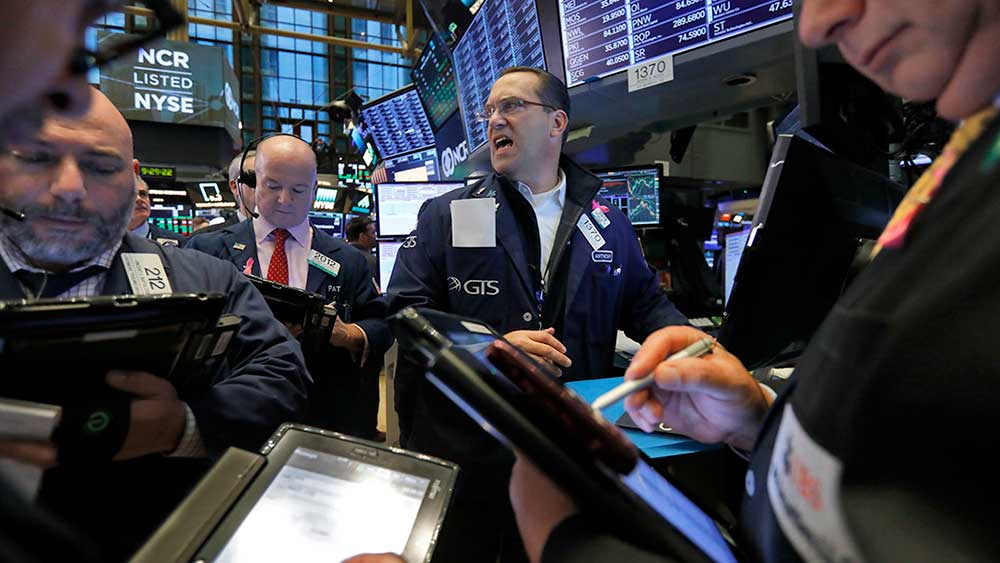 (AP) Biz05-nyse-111918-AP Traders gather at the post of Anthony Matesic, center, on the floor of the New York Stock Exchange, Wednesday, Nov. 7, 2018. Stocks are climbing in early trading on Wall Street as results of the U.S. midterm elections came in as investors had expected. (AP Photo/Richard Drew)