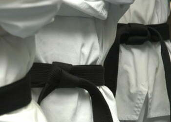 Black belts standing.