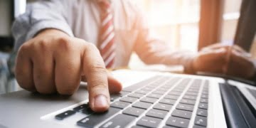 hands of business people typing on a keyboard - Should You Start An Online Business: 4 Things To Consider First