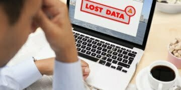 Businessman stressed with lost data