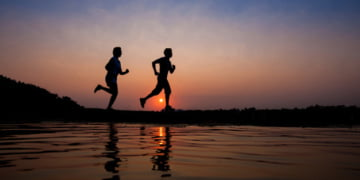 silhouette-of-man-and-woman-running