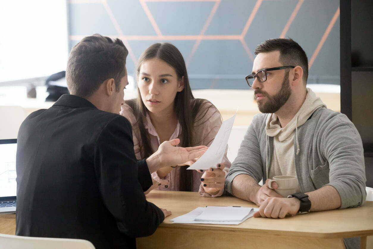 Millennial couple discussing person injury suit