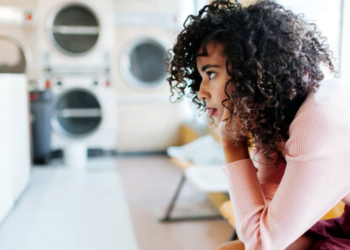 Frustrated woman waiting for laundry