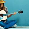 girl-playing-guitar