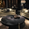 Large-round-coffee-table-in-black-for-the-spacious-living-room