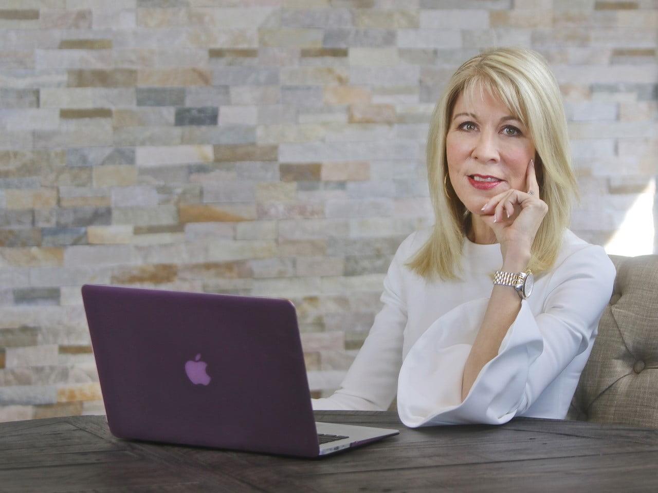 Janet Ioli at desk