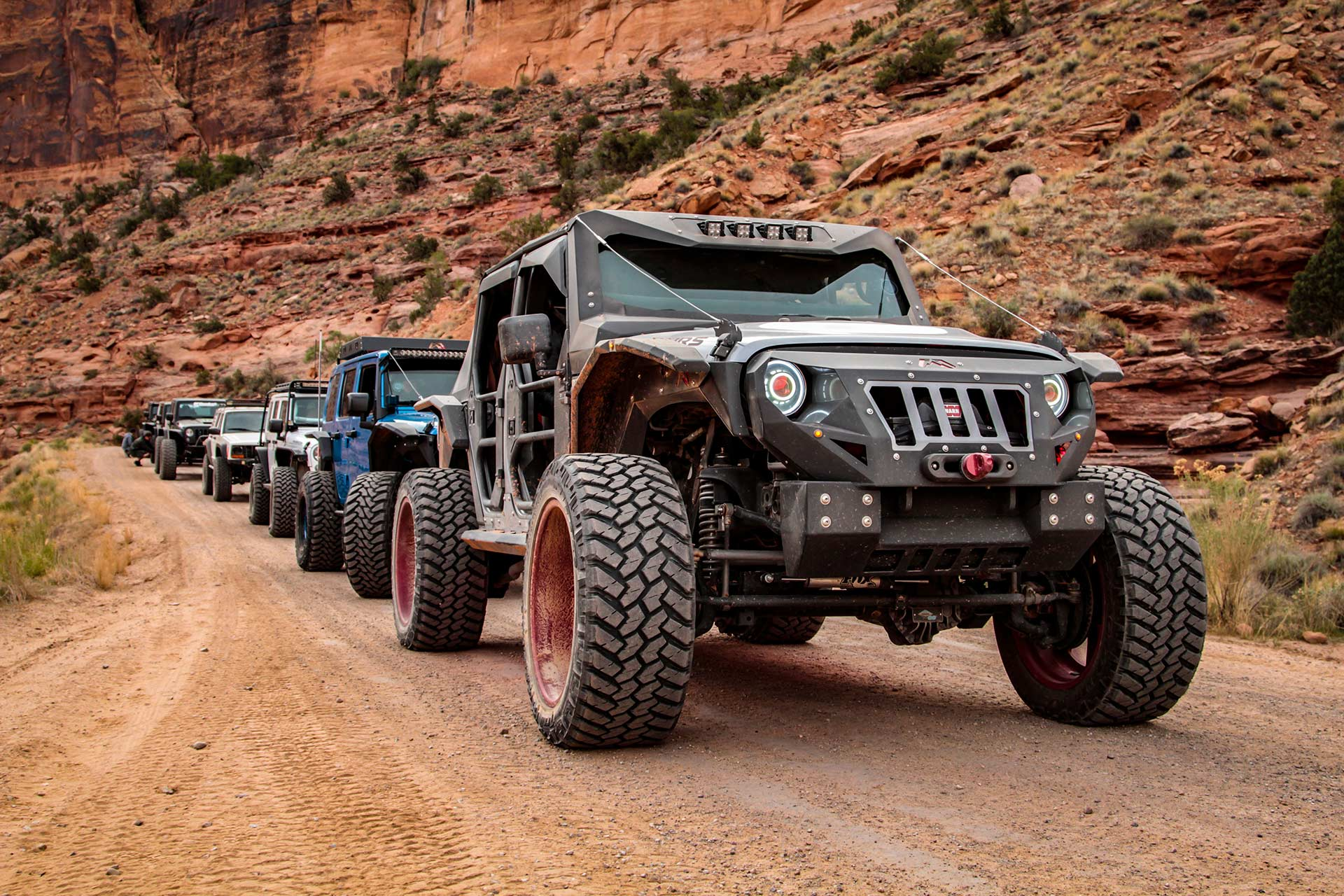 Off-road vehicles in a line